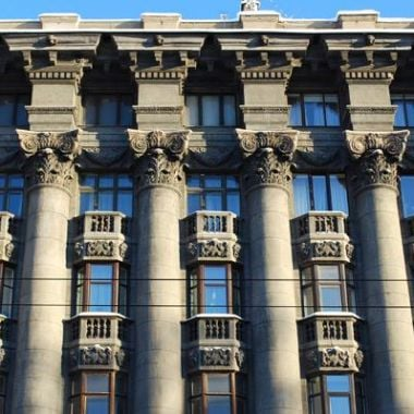 Architectural Style Neoclassicism in the Outdoor Decoration of the House Front (photo)