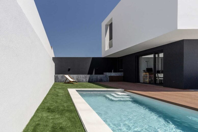 BLACK AND WHITE INTERIOR & EXTERIOR TWO-STORY HOUSE DESIGN