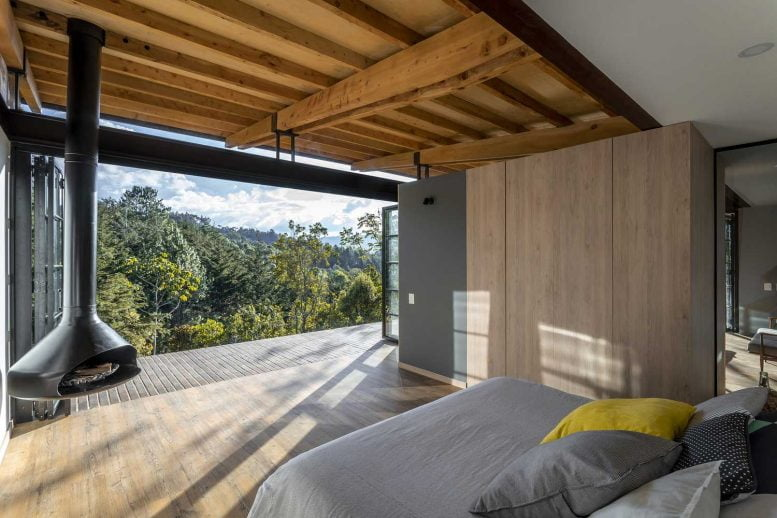 Small Wooden House Design on a Steep Slope / Mountain Cabin